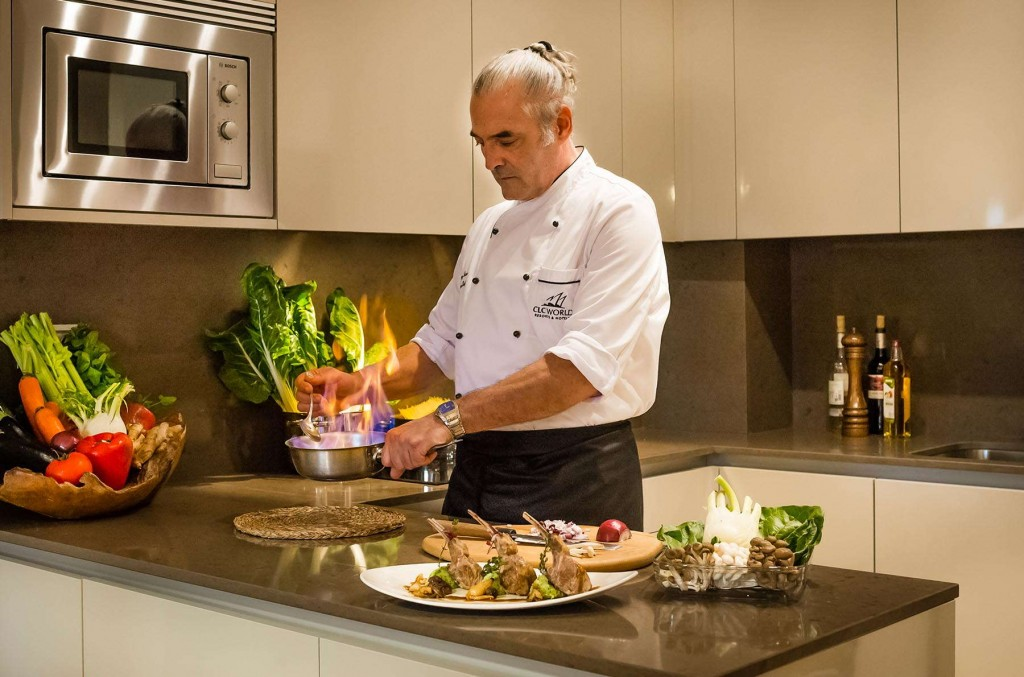 Private chef preparing a delicious dinner for a Santa Cruz Signature Suite owner