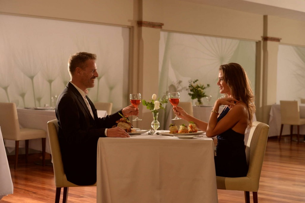 Couple enjoying a romantic dinner at San Diego Suites