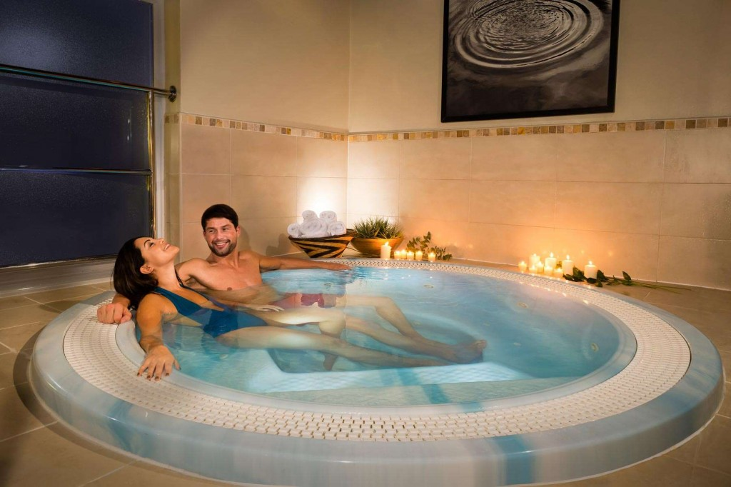 Guests appreciating the relaxing jacuzzi at Trenython Manor