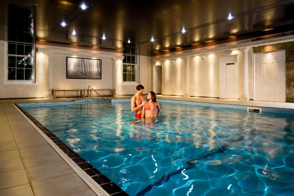 Guests enjoying the heated indoor swimming pool at Trenython Manor