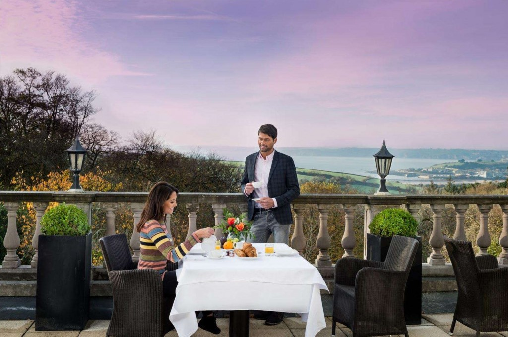 Guests enjoying a delicious breakfast and the spectacular view from Trenython Manor
