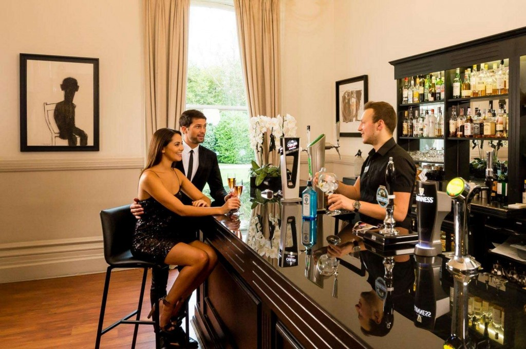 Guests enjoying some drinks in the bar at Trenython Manor
