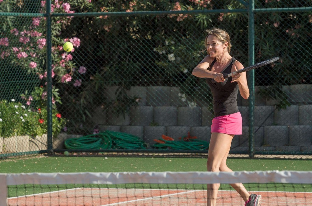 Guest playing tennis in beautiful tennis court