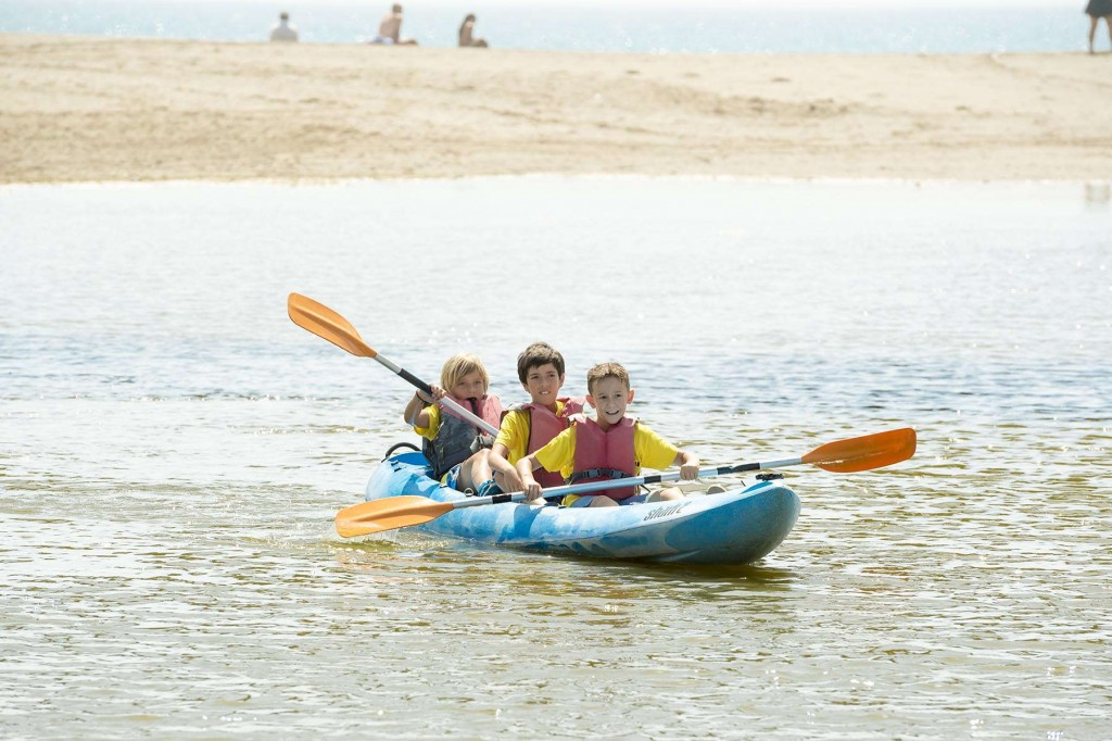 Younger guests having fun kayaking along the river