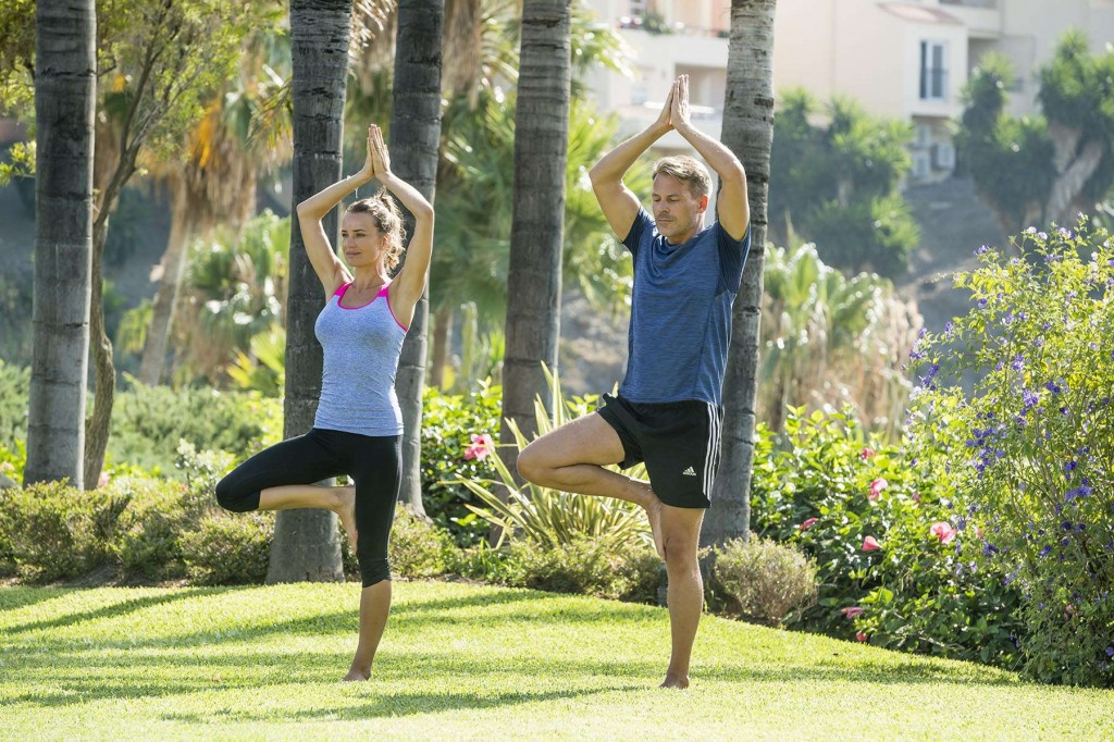 Couple doing yoga together in the Marina del Rey gardens