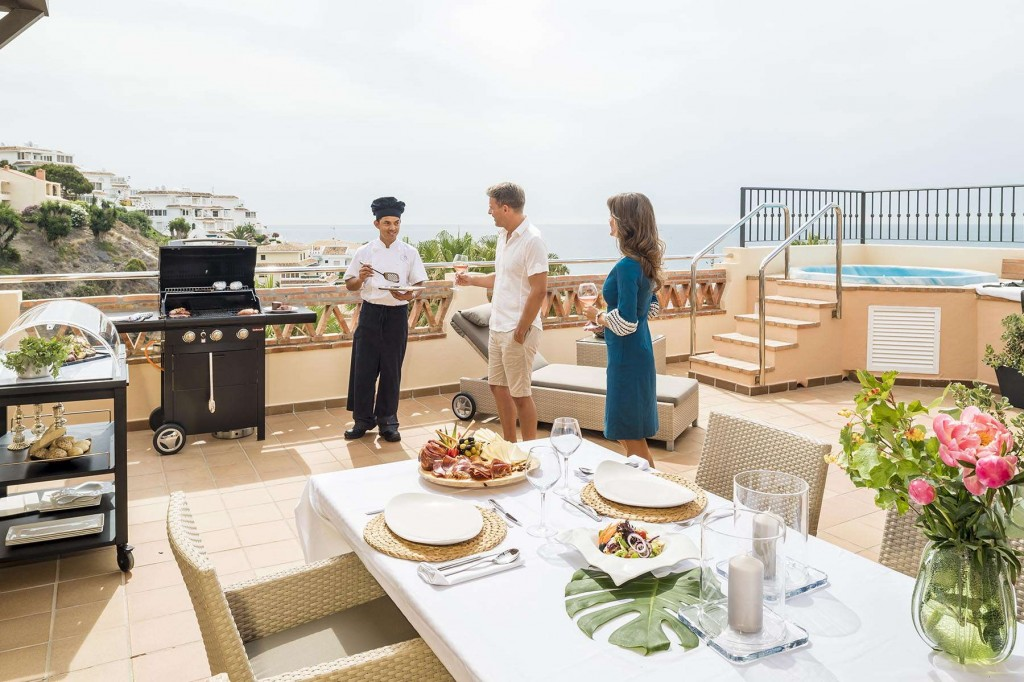 Guests enjoying a barbecue on the terrace at CLC World